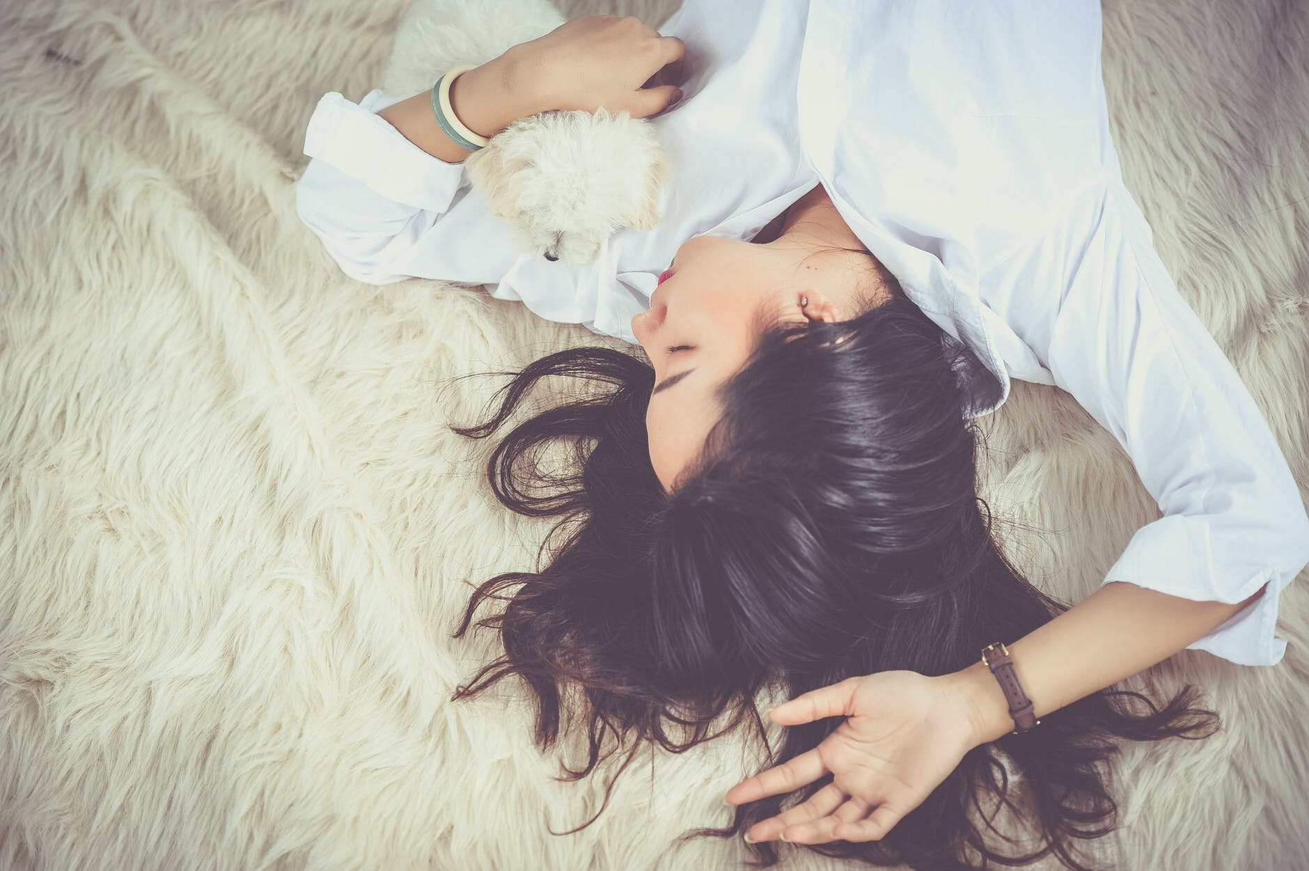 Dark haired woman lies unconscious on a rug