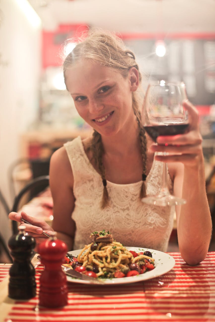 Woman at dinner with wine