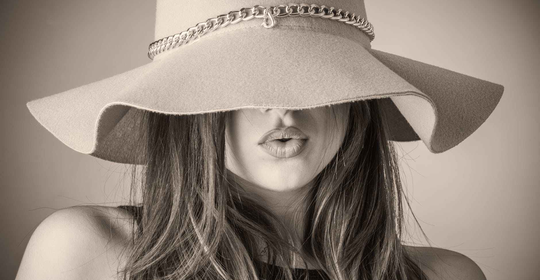woman with long hair in a hat