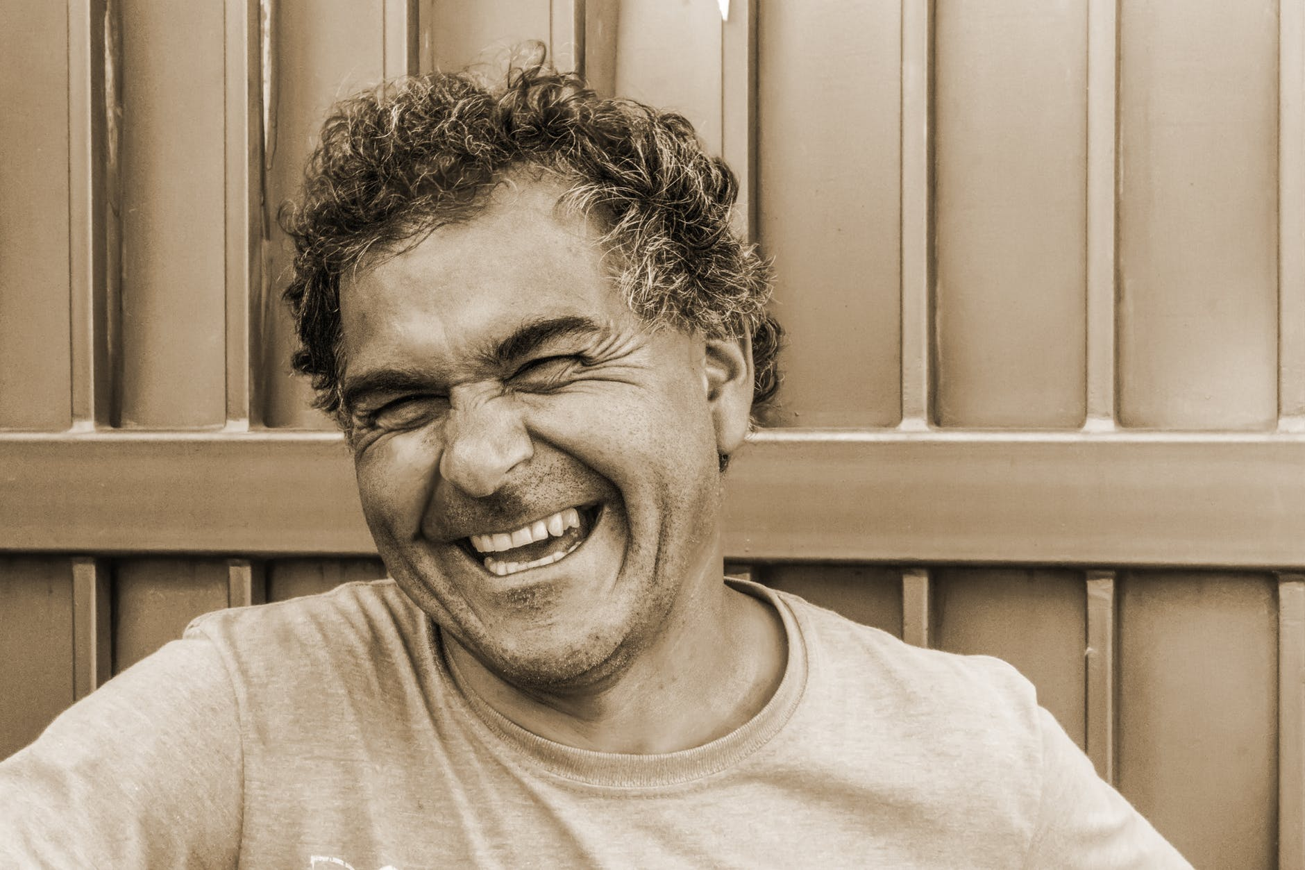 man laughing with sepia filter