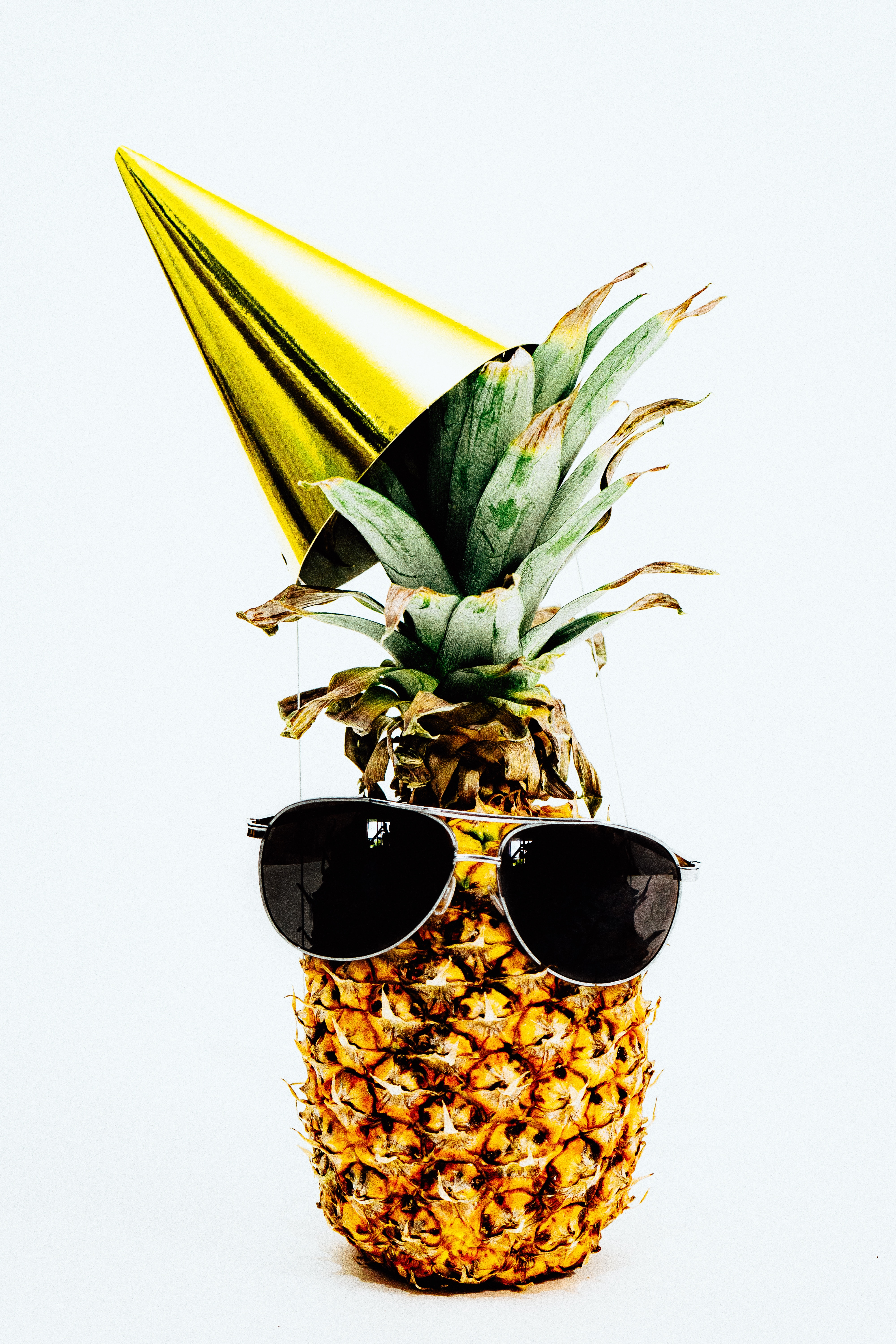 Pineapple wearing shades and a party hat