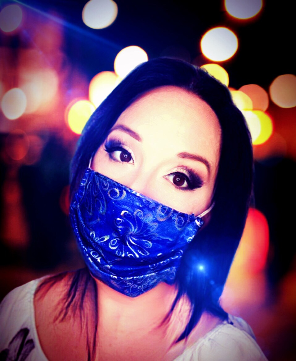 Dark haired woman in blue face mask