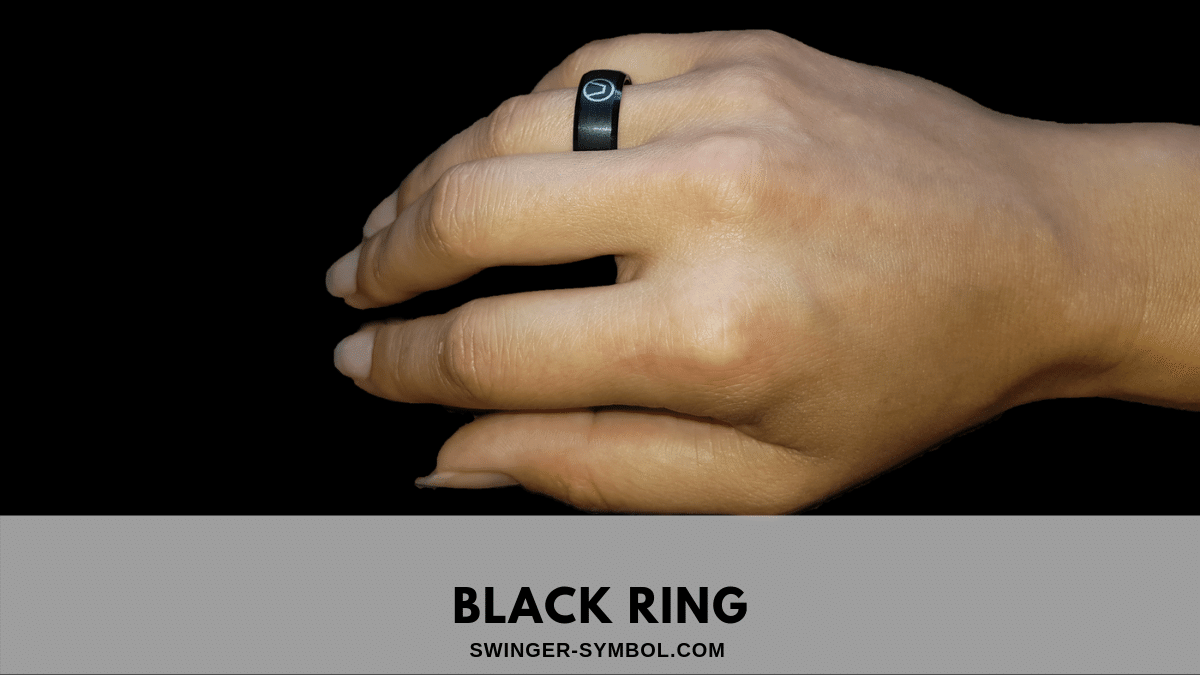 Black ring on the hand with a swinger symbol