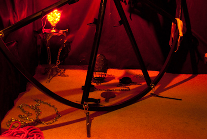 Image of wheel and red light in the dungeon at Pleasures in Kent