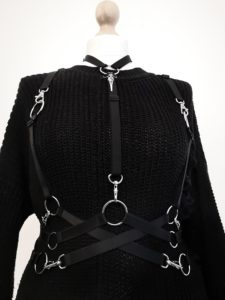 Harness by Bound UK over a black jumper on a mannequin