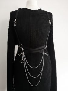 Harness with chains by Bound UK on a black knitted dress on a mannequin